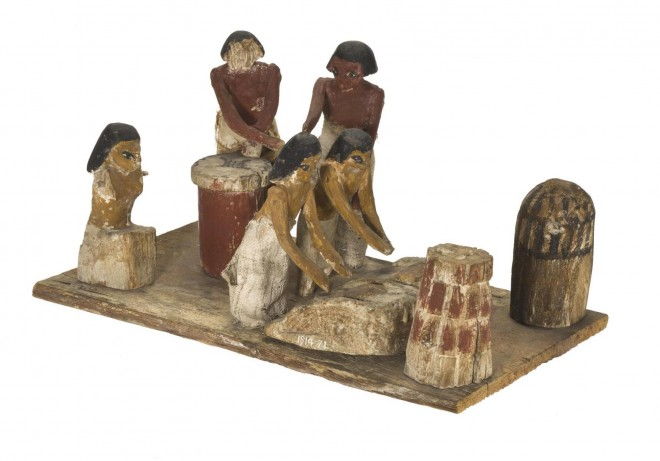 A wooden tomb model of a bakery from Beni Hassan, Egypt [A.1914.71]. © National Museums Scotland